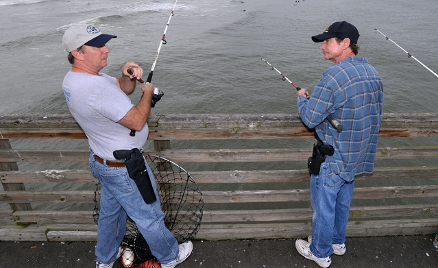 pier fishing with guns